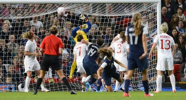 Alex Morgan's header flies past Canadaian keeper Erin McLeod. Greatest moment in history