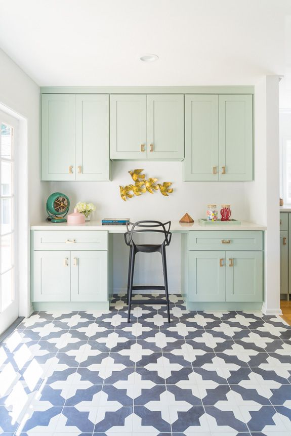 Beautiful mint kitchen cabinets, patterned tile floor, gold accents, quirky design details // unique kitchen design inspiration