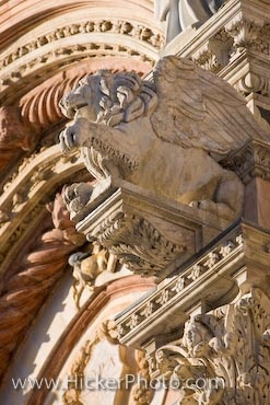 Photo of a winged lion and details on the facade  of the Siena Duomo, City of Siena, Tuscany, Italy.