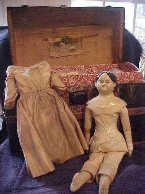 American Greiner papier-mache doll retains its original paper label dated March 30, 1858.