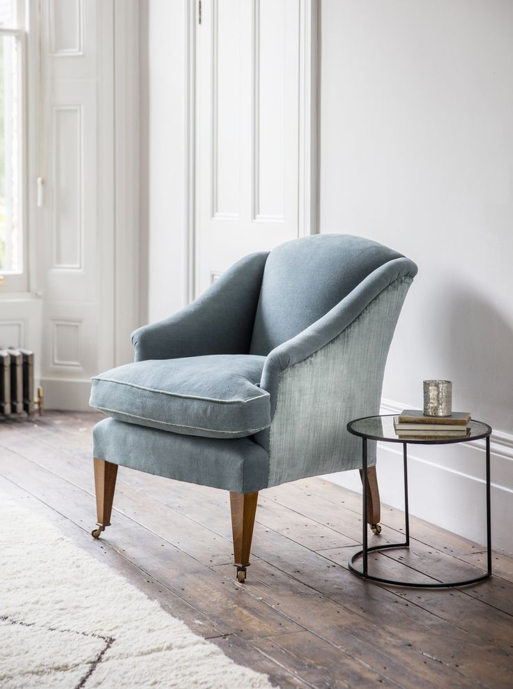 The Fielding chair is a compact and elegant armchair with subtly scrolled arms and a high back.