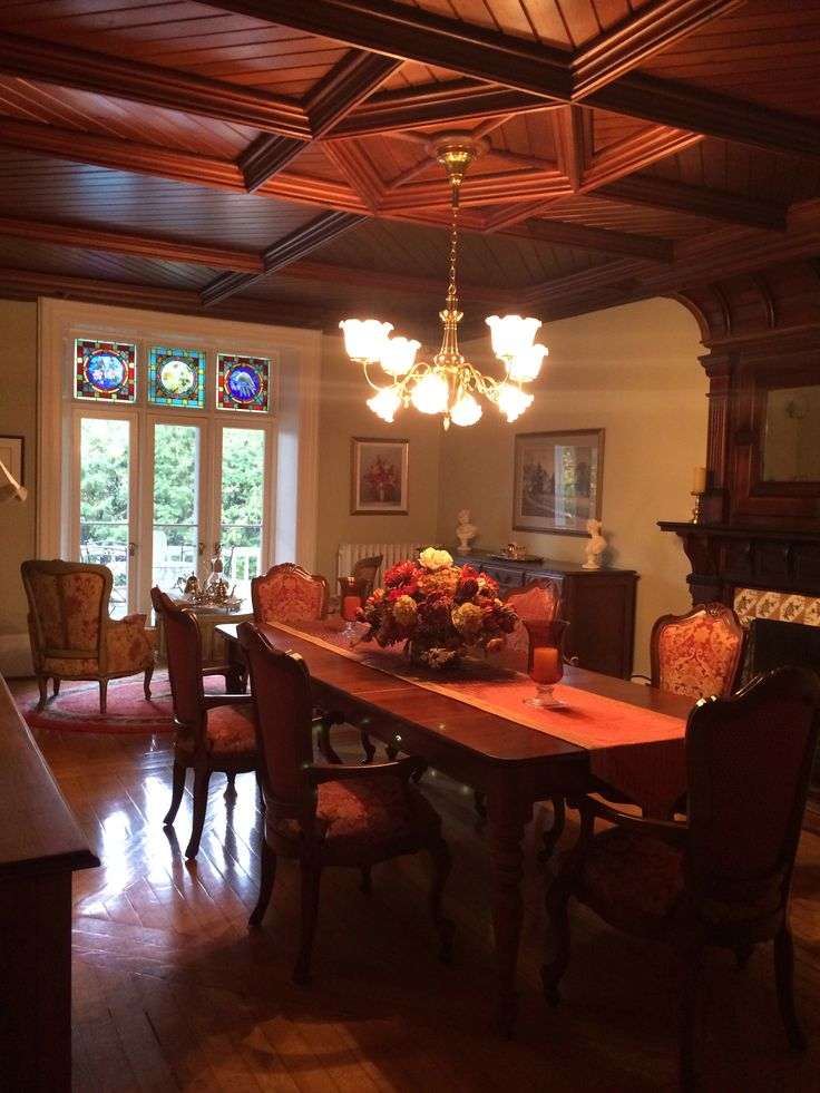 The dining room with its lovely fireplace and Eastlake crafted ceiling
