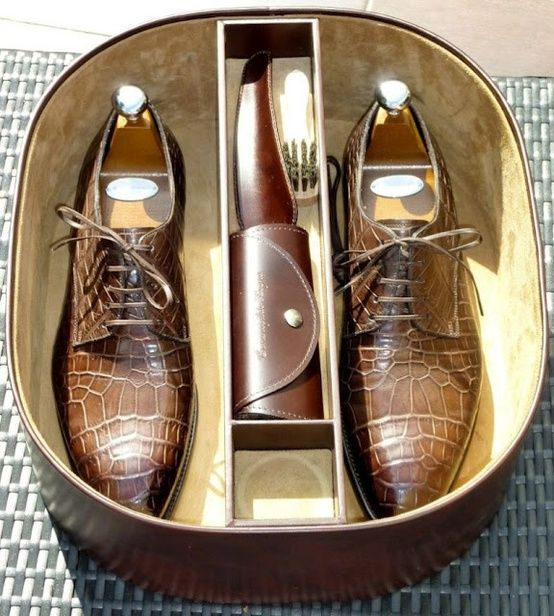 Beautifully lined shoe case with shoe trees, and a leather-wrapped shine brush
