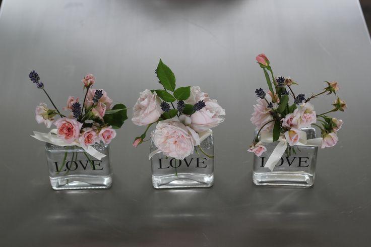 love bottles of roses http://www.wanakaweddingflowers.co.nz/gallery/