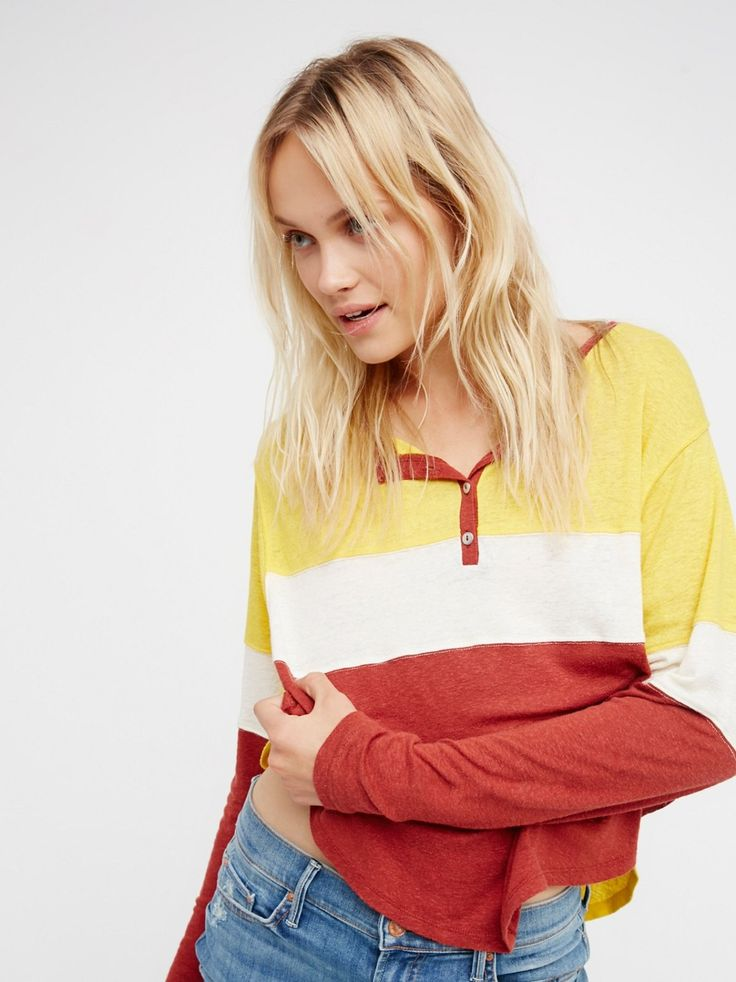 We The Free So Seventies Tee | Cool and effortless, this retro-inspired long sleeve henley tee features dolman style sleeves and front button closures.    * Semi-sheer fabrication   * Bold striped design