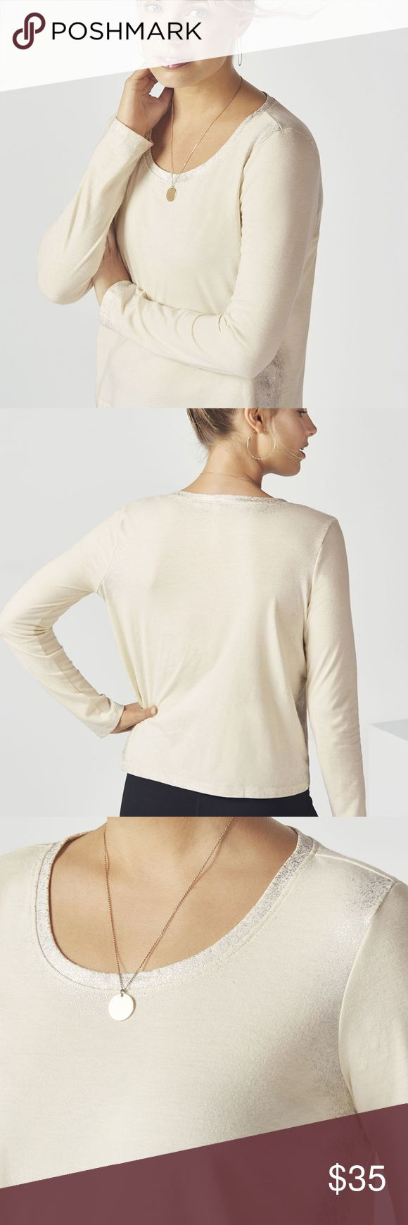 Fabletics Long Sleeve Laurel Top NWT Get your glow on from home or on the go in a comfy long sleeve tee with a standout shimmer effect along the edges. Fit: Regular Fit Length: Semi-Cropped Styling: Semi-Cropped Length, Soft Jersey Fabric, Distressed Foil Print on Seams and Hem Fabric: Cotton Jersey (A luxe cotton knit, washed with silicone for an ultra-soft finish.) Fabric Content: 50% Polyester/50% Cotton XL | 14-16B: 42-44 W:35-38  H:44-46 Fabletics Tops Tees - Long Sleeve