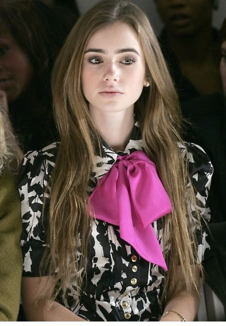 Lily Collins wearing Pretty in Pink Blouse at Mercedes Benz Fashion Week.
