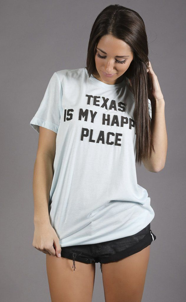 """Rep your fave state in this super soft t shirt! It features a light blue fabric with charcoal colored puff paint lettering. - Parker is 5'2"""" and is wearing a size medium - fits true to size - size up"""