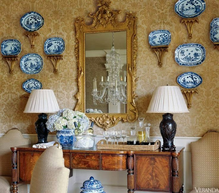 Sideboard, blue and white porcelain on brackets, damask walls, hydrangeas