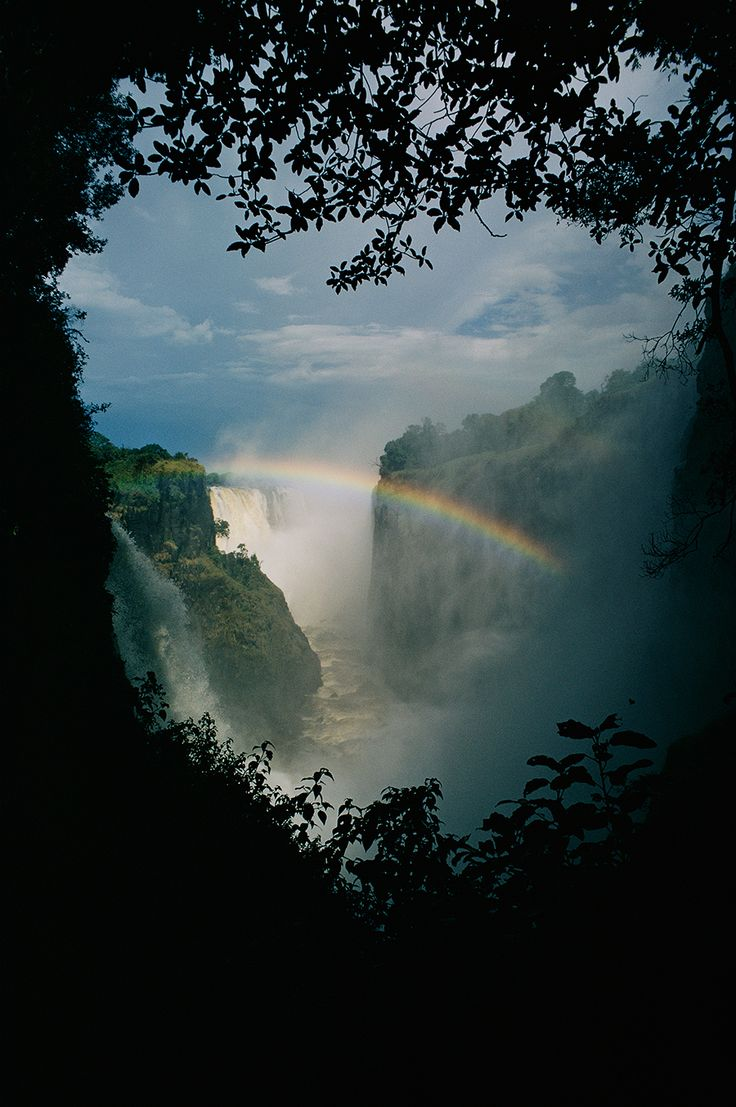 A rainbow arches over Victoria Falls in Zimbabwe. Photograph by Volkmar Wentzel, National Geographic Creative