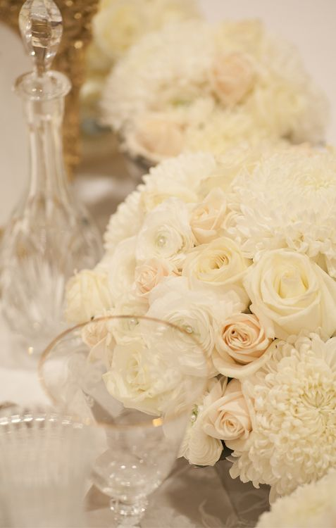 White chrysanthemum, champagne and white roses centerpiece with delicate gold trim glassware