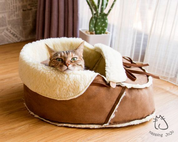 Pet Bed for shoe lovers! Cats love shoes! Dogs love shoes! A shoe shaped pet bed is like a pets dream come true!  Medium size moccasin pet bed made in Brooklyn New York. It suits pets up to 15 lbs. Most cats, small breed dogs, puppies and alike should be all able to curl up comfortably in this soft bed.  We'd love to hear everything you have to say about it. Feel free to ask us anything or give us suggestions by contacting us here. REMINDER: Return Policy varies by item. Please always read…