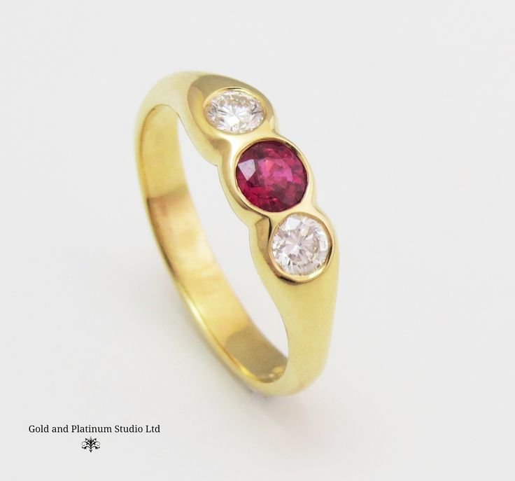 18ct yellow gold ruby and diamond three stone, rub over set ring.