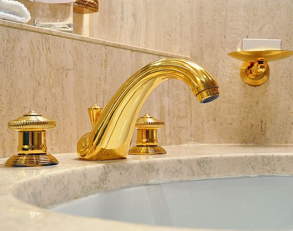How To Re Model Bathrooms For Hotels Using Gold Fixtures