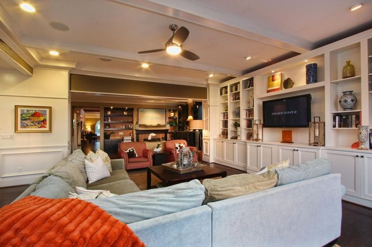Traditional Living Room with Built-in bookshelf, Exposed beam, Ceiling fan, Hardwood floors, Wainscoting