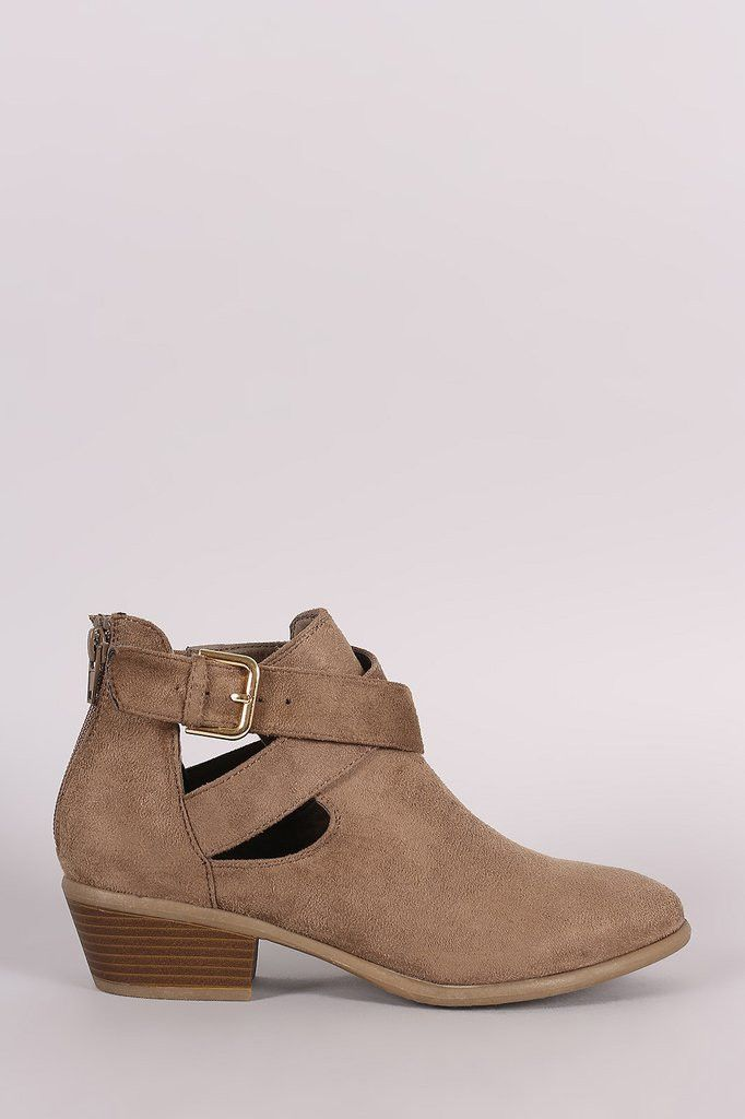 These cowgirl ankle boots feature a soft vegan suede upper, round toe silhouette, side cutout detail, and crisscross strap with buckles accent. Finished with a block stacked heel, cushioned insole, an