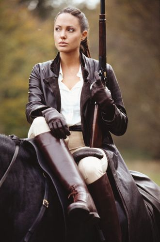 Angelina Jolie as Laura Croft.  Nothing beats an attractive woman dressed in leather.
