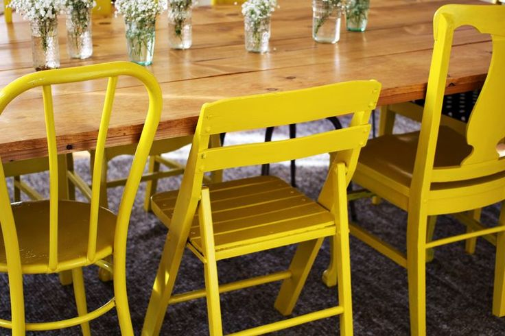 Spruce up a collection of thrifted chairs with bright yellow paint.