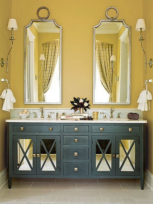 mustard yellow walls are offset by a rusty teal bathroom cabinet
