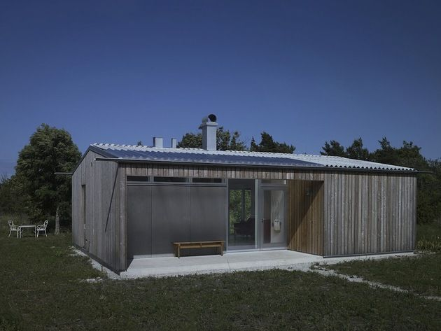 small-swedish-house-made-from-boards-corrugated-metal-1-front-angle.jpg