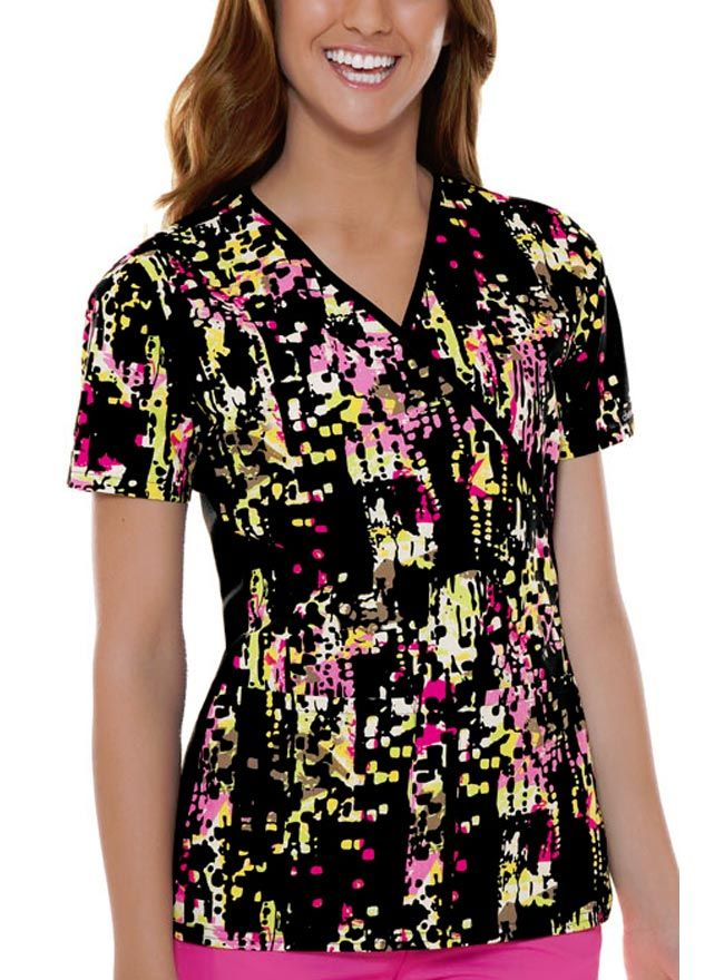 Outrageously artistic, this scrub top from Cherokee Flexibles features the Art-rageous print. This design, which is exclusive with the brand perfectly, complements the mock wrap bodice and v- shaped neckline.
