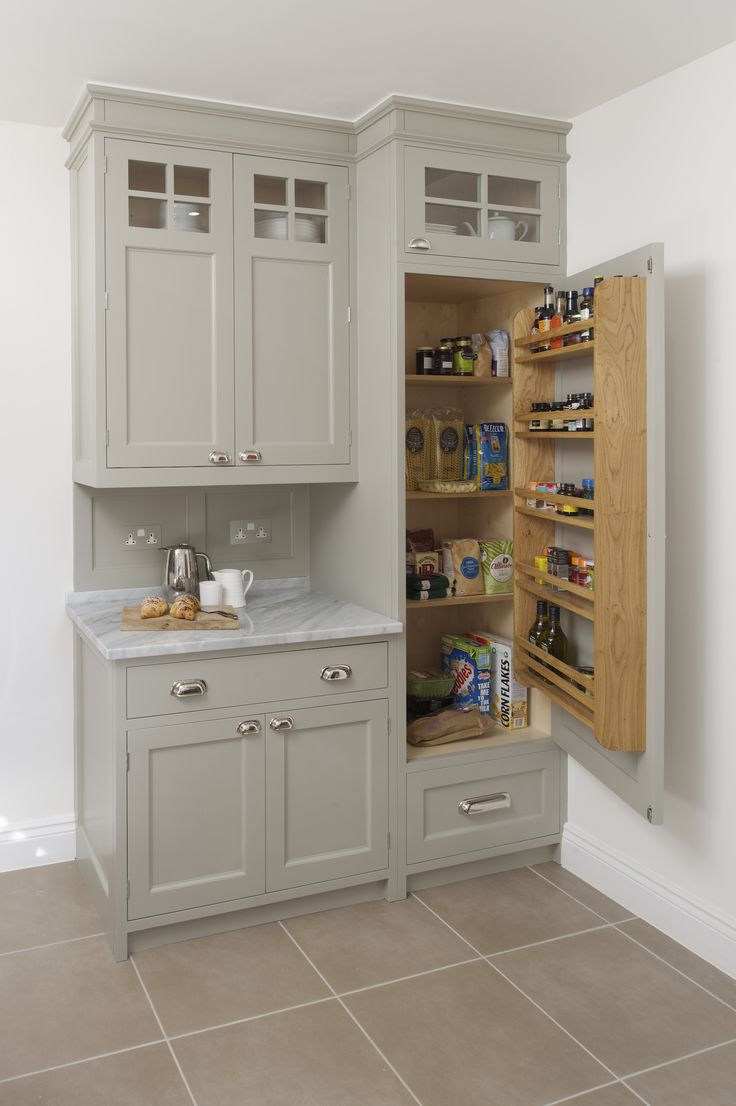 We do love a pantry or as some people prefer to call it a larder. This bespoke Inglis Hall pantry has been painted in a light grey with a cararra marble counter top. Inside the large cupboard is bespoke organisation for all your kitchen essentials
