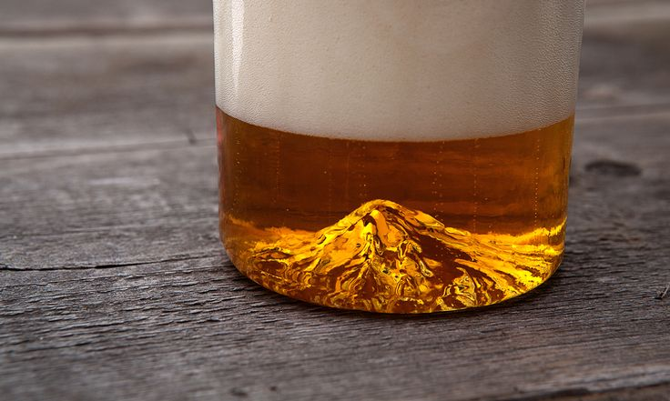 """North Drinkware combines Oregonians passion for beer & the great outdoors in """"The Oregon Pint,""""a glass featuring a miniature version of Mount Hood."""