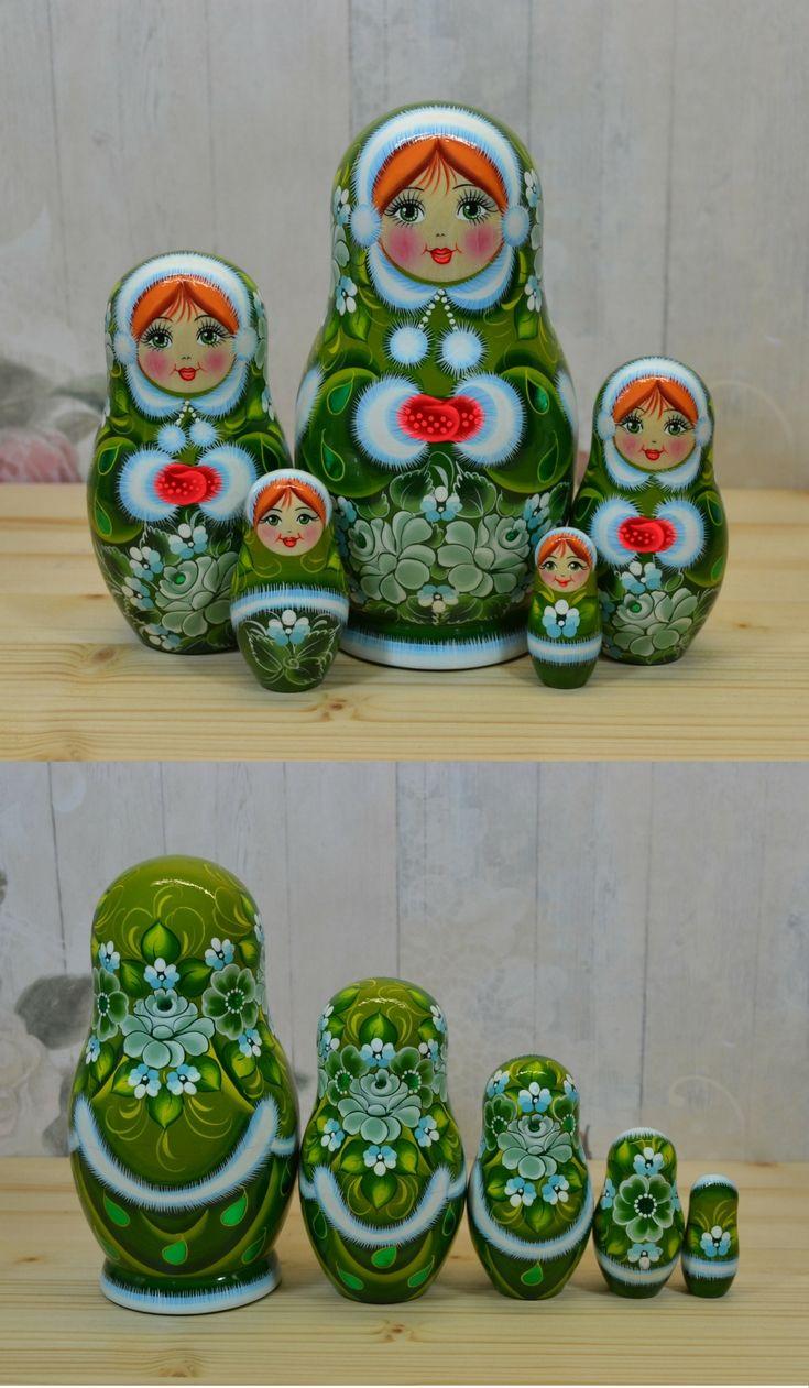 Russian nesting doll in green winter dress