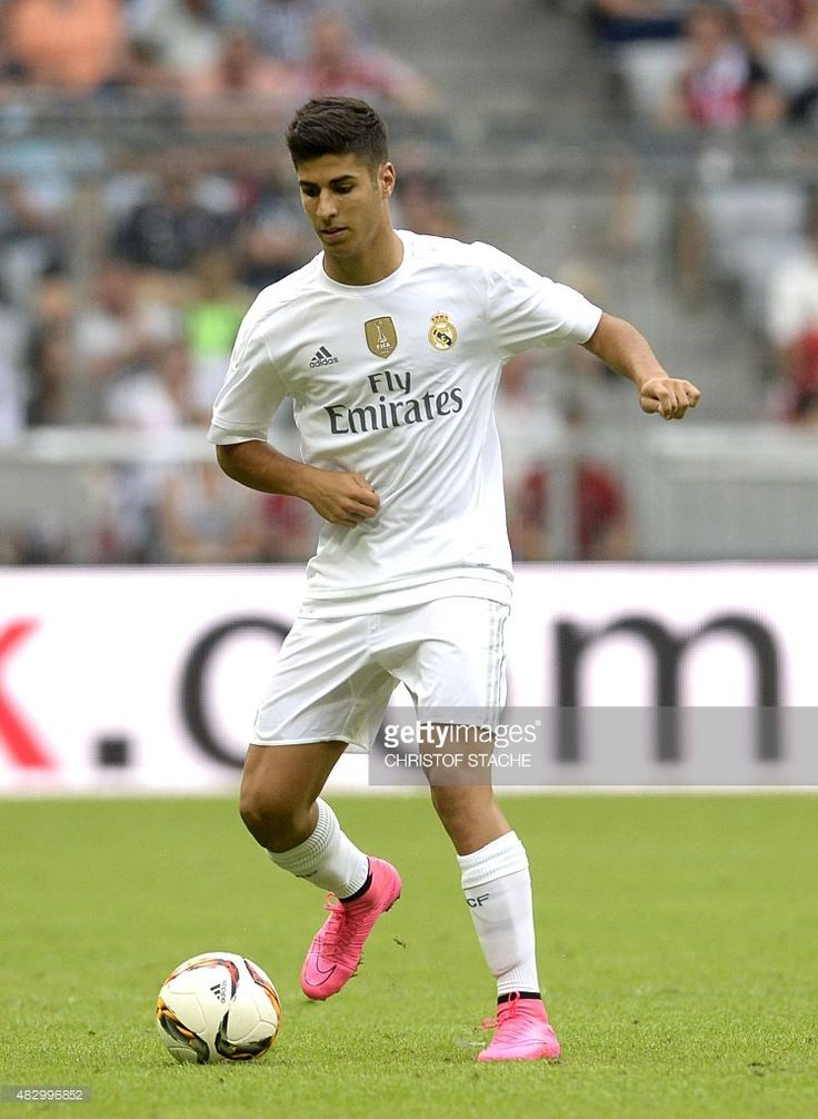 Madrid's midfielder Marco Asensio plays the ball during the Audi Cup football match Real Madrid vs Tottenham Hotspur in Munich, southern Germany, on August 4, 2015. The Audi Cup football matches with Bayern Munich of Germany, Real Madrid of Spain, AC Milan of Italy and Tottenham Hotspur of England will take place in Munich on August 4 and August 5, 2015.