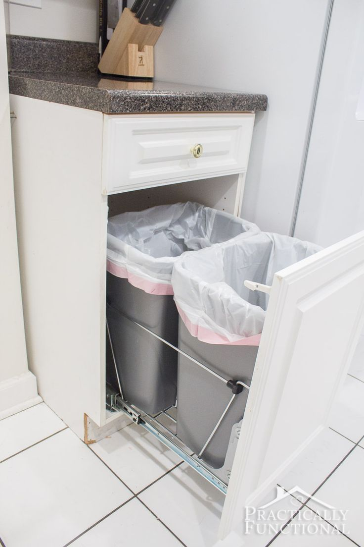 Turn an empty cabinet into DIY pull out trash cans in under an hour; so easy to do!