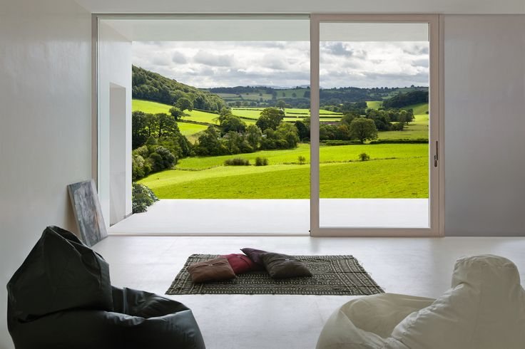 Imago Lift & Slide is the definitive timber wide-span door for design led homes. The super-slim wooden frame makes it an exciting choice for extensions, sunrooms and orangeries where style and performance is paramount.