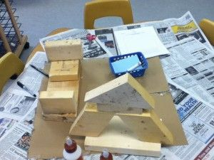Children are using wood pieces to construct their own creations during the building inquiry.