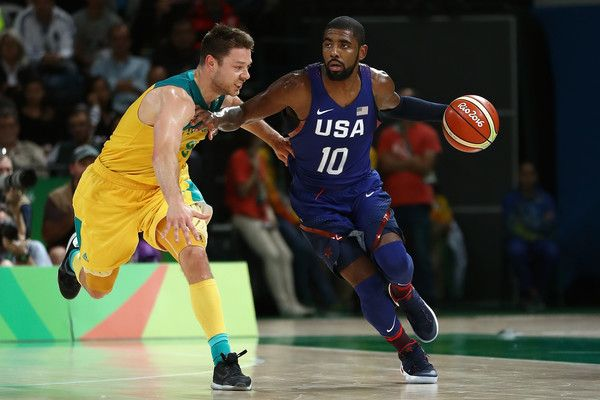 Matthew Dellavedova Photos - Kyrie Irving #10 of United States moves the ball against Matthew Dellavedova #8 of Australia during a Preliminary Round Basketball game between Australia and the United States on Day 5 of the Rio 2016 Olympic Games at Carioca Arena 1 on August 10, 2016 in Rio de Janeiro, Brazil. - Basketball - Olympics: Day 5