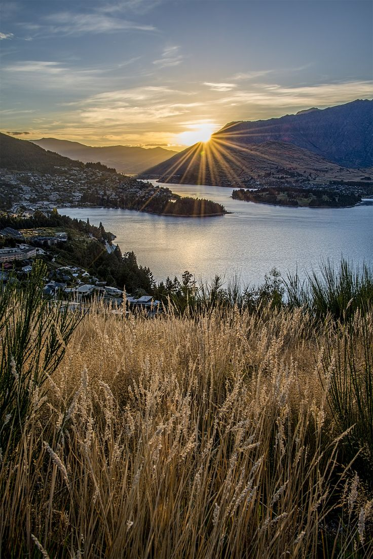 Moons and years pass by and are gone forever. But a beautiful moment shimmers through a ray of light. - Franz Grillparzer  I took this beautiful and calming scenery 2 years ago. The sun rising over Queenstown, New Zealand.  I got a lot of wonderful travel stories. For more of it, follow my photo diary and let's socialize! www.onthreelegs.com  ‪#‎NewZealand‬ ‪#‎Queenstown‬ ‪#‎Sunrise‬ ‪#‎Photography‬ ‪#‎ThrowbackThursday