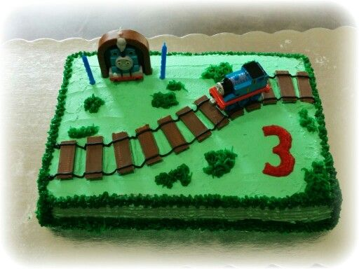 Thomas the train birthday cake, use Kit Kat bars cut in half for railroad tracks!