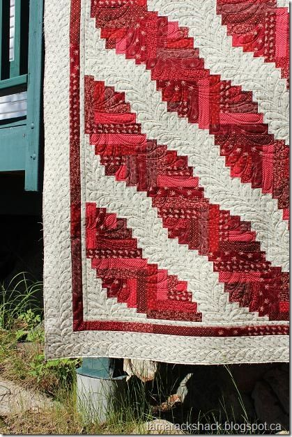 Curved Log Cabin - again, picture the white as black, and the red as multi-batiks