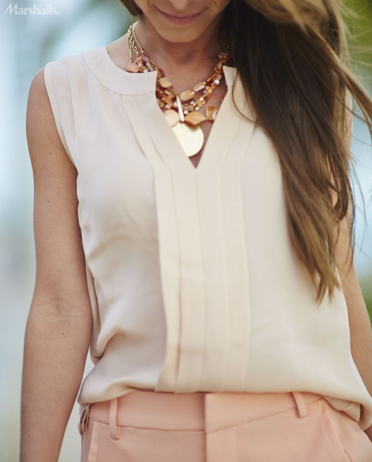A sleeveless peach blouse is perfect for spring. Tuck it in for an extra-chic touch.