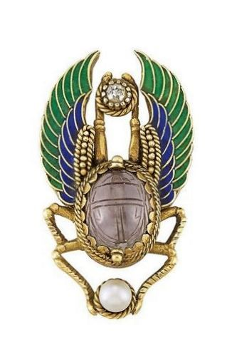 An Egyptian Revival Gold, Amethyst Scarab, Enamel, Pearl and Diamond Pin. The stylised beetle centring one oval amethyst scarab, tipped by one pearl, and one old-mine cut diamond, its wings applied with green and blue enamel, circa 1870.