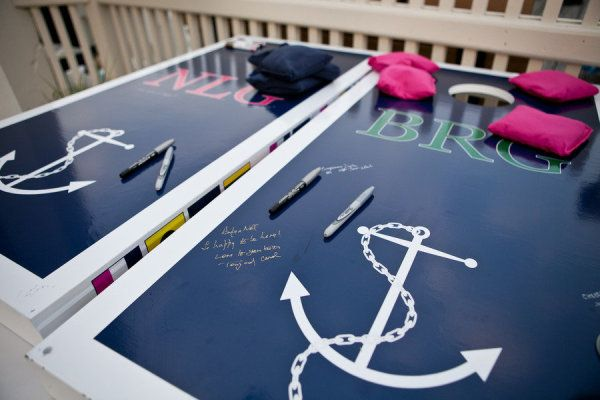 Anchor cornhole guestbook. Photography by meghansepeweddings.com, Floral Design by sarahrogersflowers.com