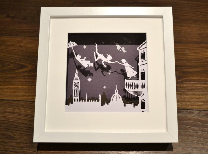 Peter Pan original hand made papercut scene. We can change the background colour behind the 3d frame if you have a different colour in mind that would match your room. Available in our shop and more pictures can be seen on our website. price: £33