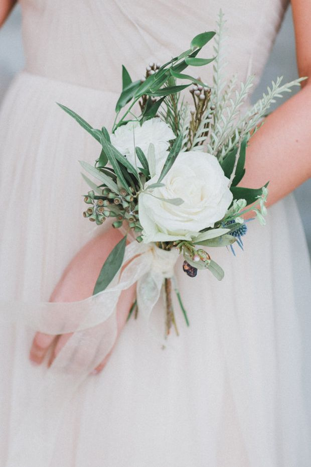 Beautiful white and green bridesmaid corsages                                                                                                                                                      More