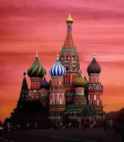 Willie Wonkas Chocolate Factory!!!....just kidding! :P It's:  St. Basil's Cathedral in Moscow, Russia. Gorgeous structure.