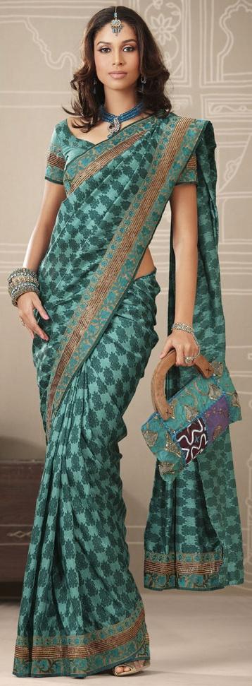 Teal green color dupion raw silk printed saree