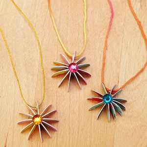 Repurpose old greeting cards into beautiful flower pendants.