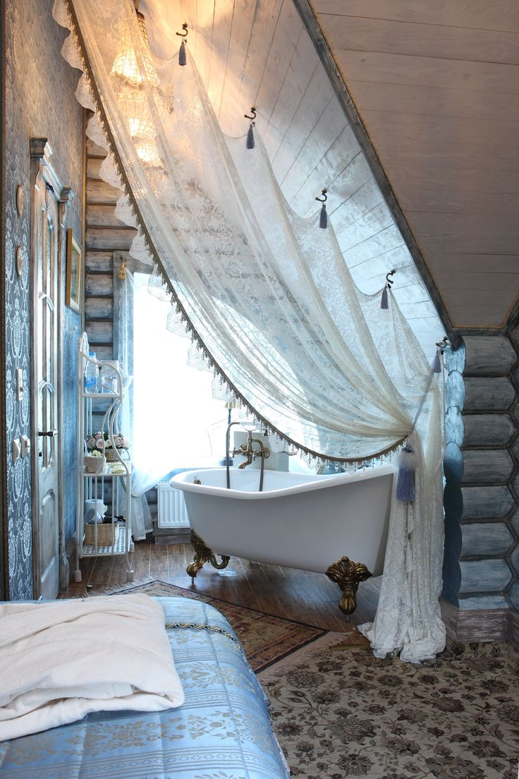 A white curtain as room divider in a loft. LOVE this. I want my master suite tub to fit like this in the loft