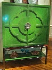 Latest furniture designs get a modern shine from high-gloss surfaces. Painted lacquer in leaf-green highlights Century Furniture's Chin Hua bar cabinet, which sits atop a stainless-steel base.