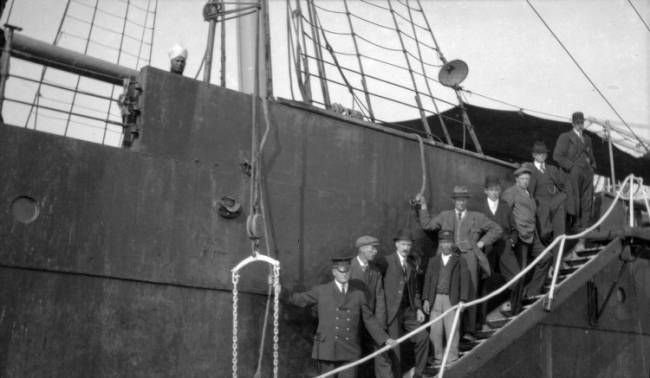 ['Komagata Maru' with officials on ladder]