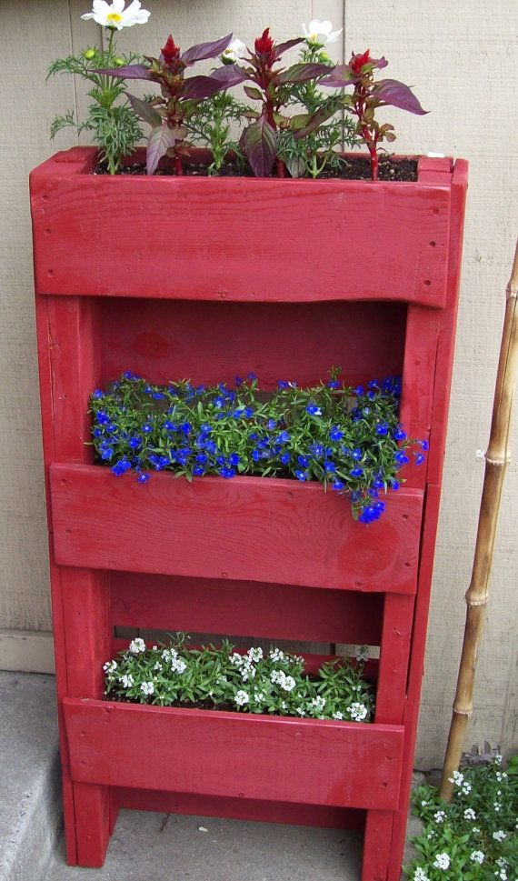 Vertical planter upcycled from a pallet.    You know.. can I pause for a moment. It is not as easy as Pinterest makes it look to acquire pallets. That is all....