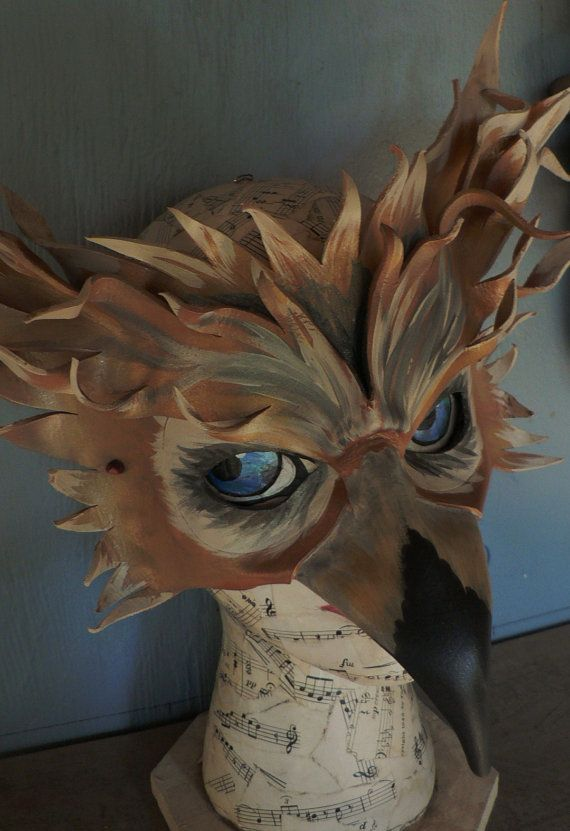 """I like this mask because it is an interesting impression of an owl with its beautiful """"feathers"""" at the back of the mask and the long curving beak."""