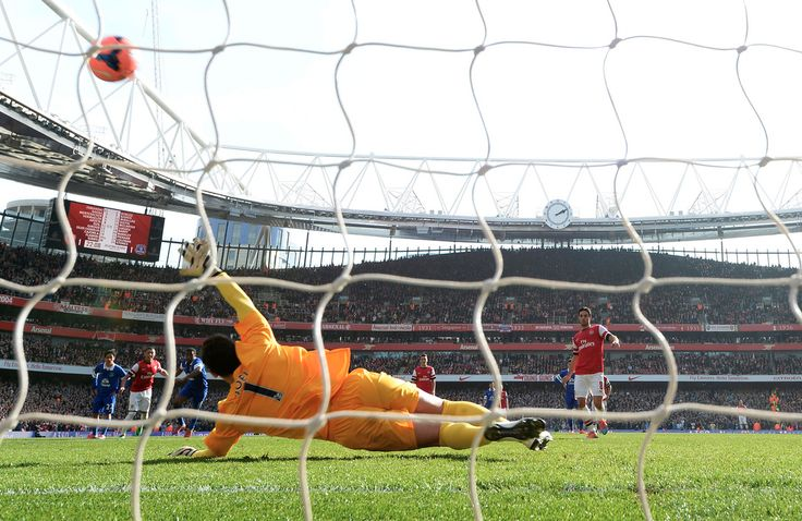 Mikel Arteta shoots past Everton goalkeeper Joel Robles to score the second Arsenal goal during the FA Cup Quarter-Final match. Arsenal 4-1 Everton (March 2014) by Stuart MacFarlane